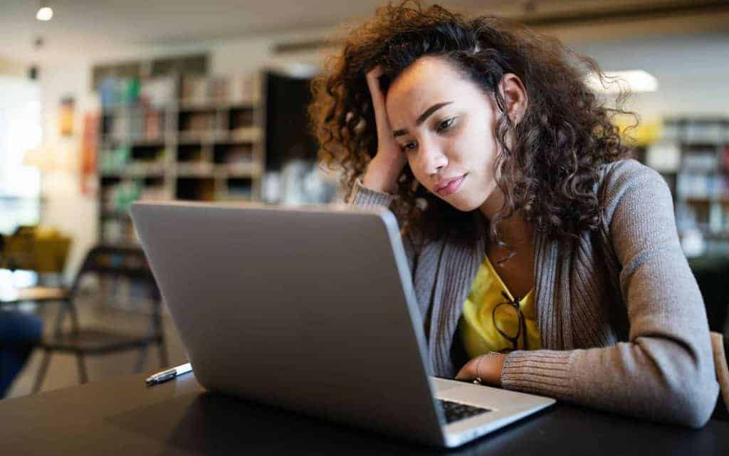 Student woman finding it difficult at study and comprehend scool tasks